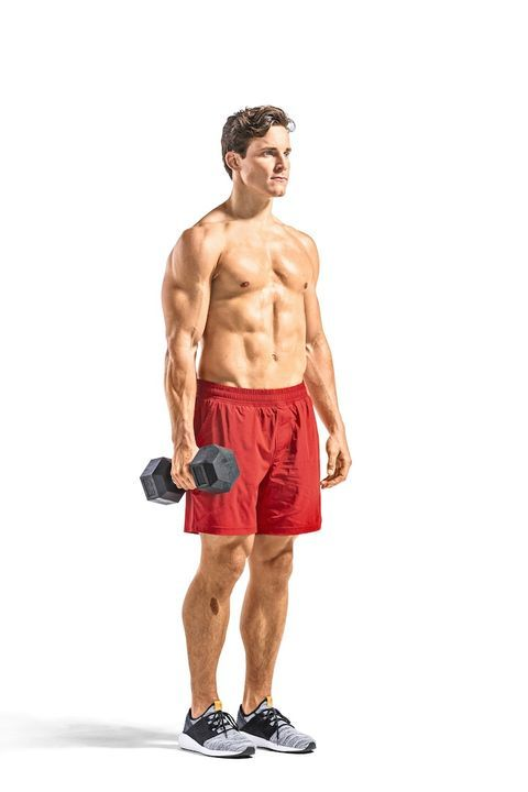 Athletic Guy Execute Exercise With Dumbbells, In Gym Stock