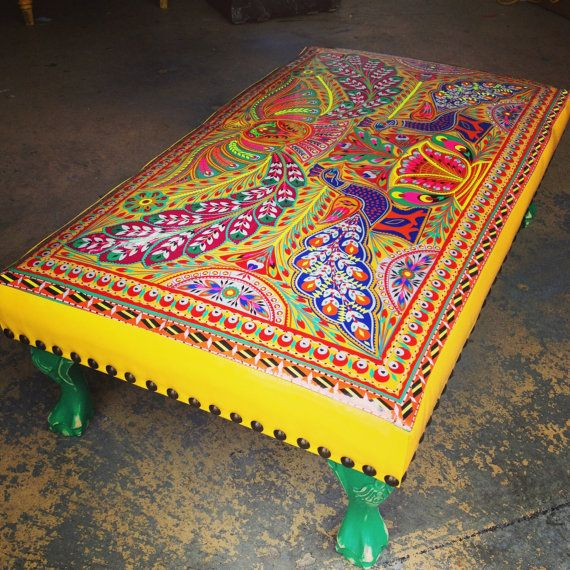 The ottoman is a unique piece. It's upholstery is all hand made by joining small pieces of intricately hand cut rexene stickers called Chamak Patti. This art is unique to Pakistan and specific to privately owned trucks and public transportation.