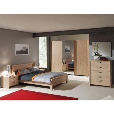 Cette chambre à coucher est composée dun lit de deux tables de chevets dune commode à 4 tiroirs dune armoire à 3 portes coulissantes et même dun