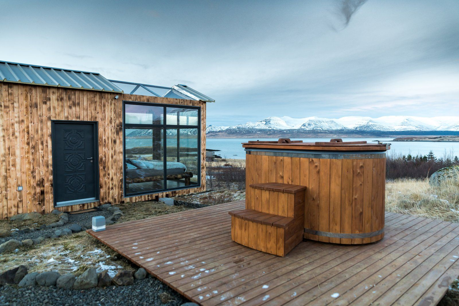 This Tiny Glass Cabin Lets You Sleep Under The Northern Lights Glass Cabin Pool Hot Tub Tub Pools
