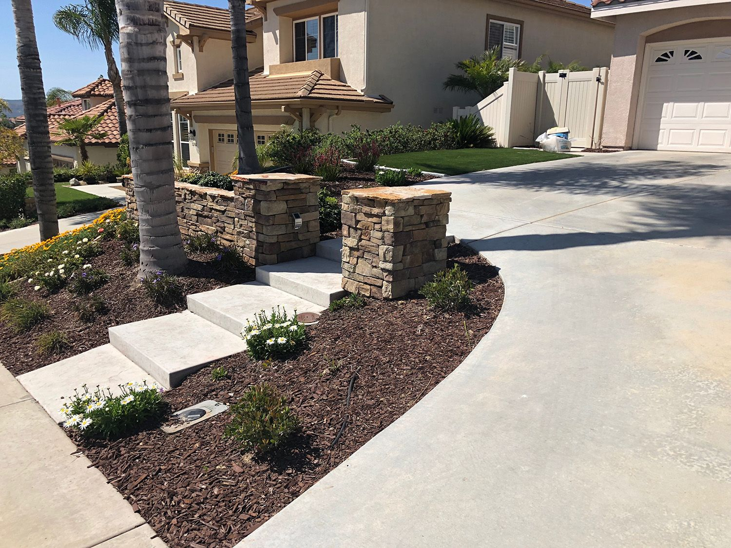 A Front Yard Landscape With Grey Stamped Concrete Steps Pilasters And Walls With Stone Facin Front House Landscaping Front Yard Landscaping Yard Landscaping