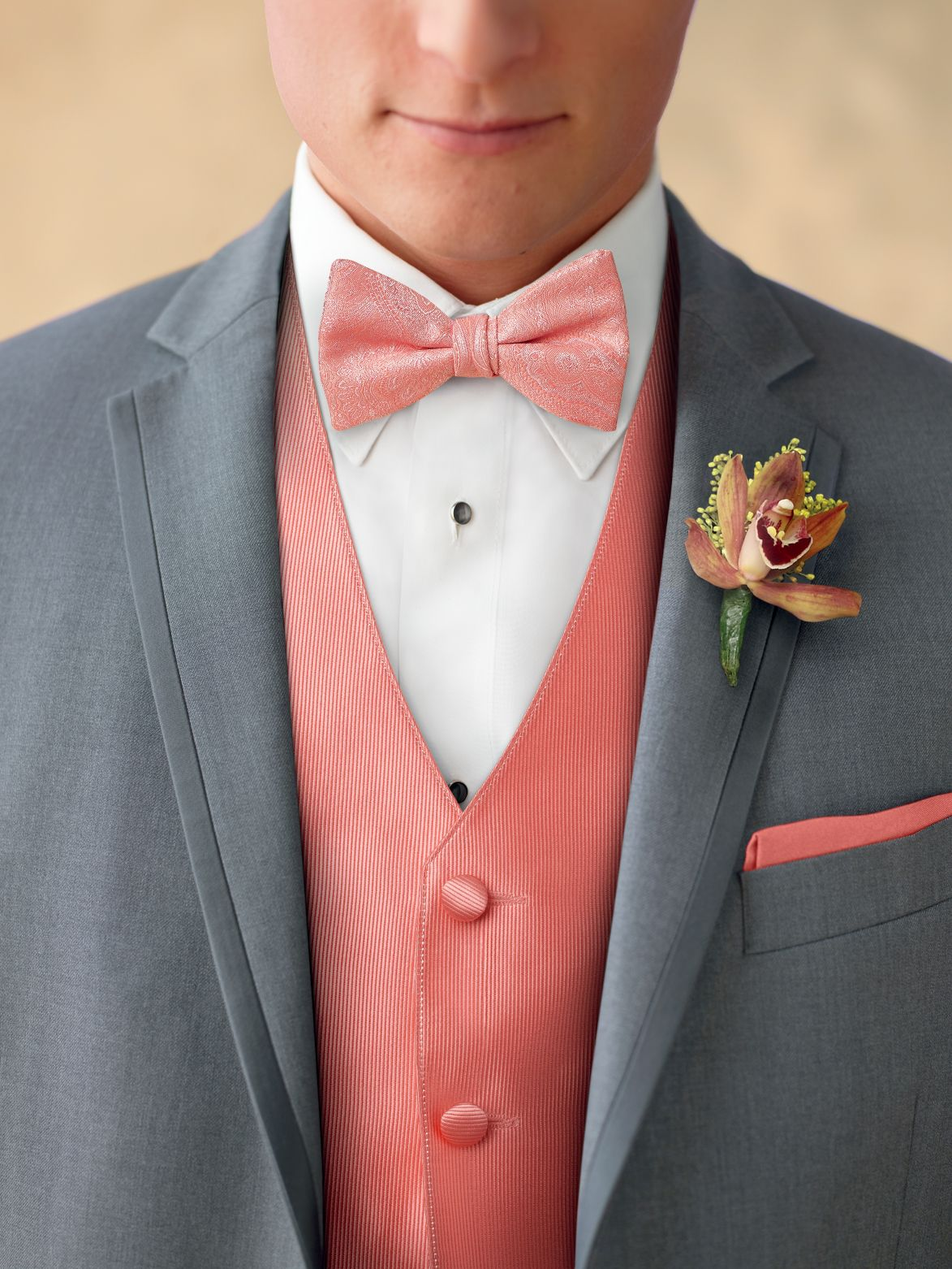 Coral accessories help bring a grey tuxedo to life. | Prom ideas ...