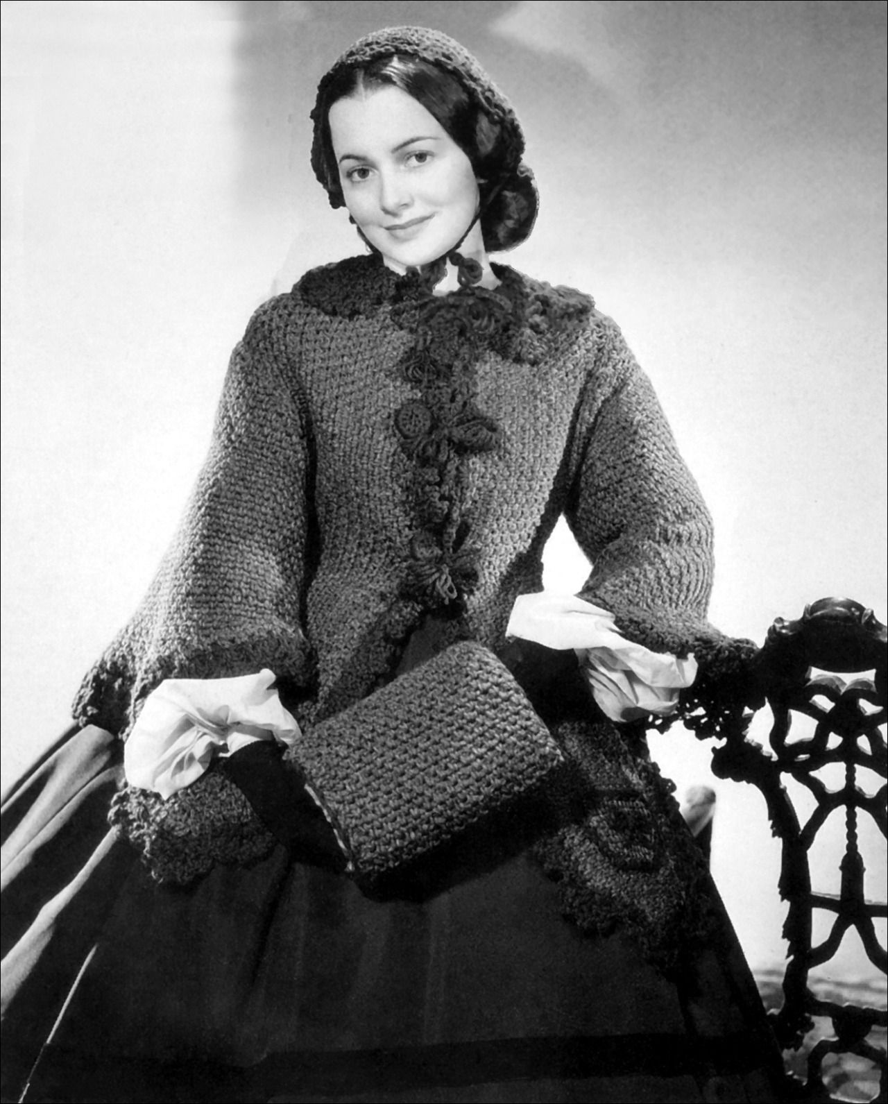 This knitted wool coat was first worn by Olivia de