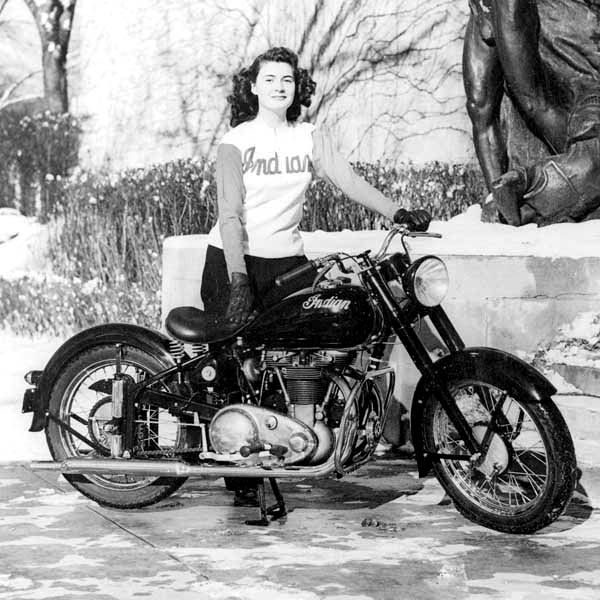 Vintage pic of woman rider on her bike! The look on her face says it all!!