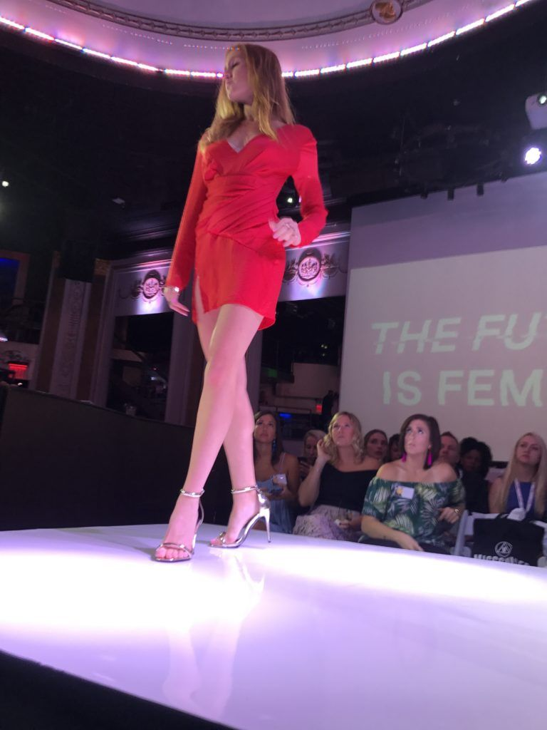 Missguided on the runway at awin fashion show red wrap dress