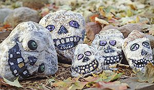 Painted skull rocks. Sharpie + Rock = My kind of budget-friendly Halloween craft!