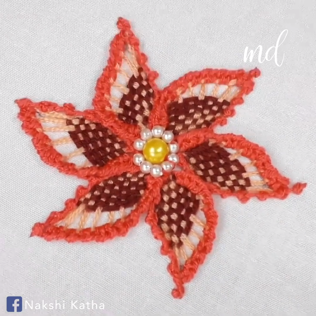 Beautiful flower design with woven spider web & buttonhole stitch.
