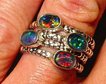 Opal stacker rings.Vivid Natural Australian Opals. Set in Handmade Sterling Silver settings. Price is for one ring.