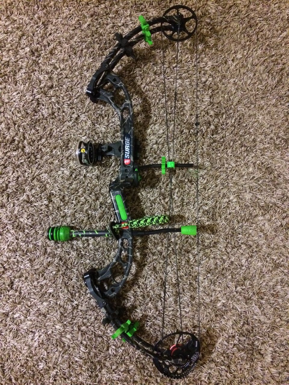 PSE Surge Compound Bow in Skillworks finish with green