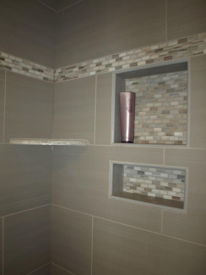 Wall Tiles And Recessed Tile Shelving Both Oriented Horizontally