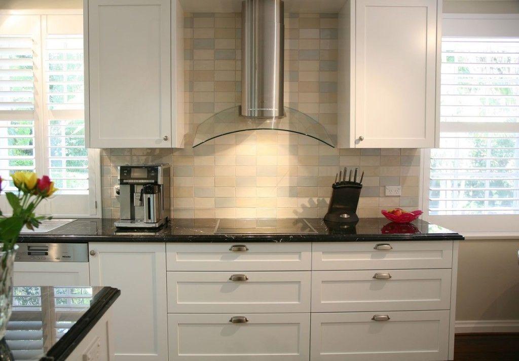 Tiled splashback in hamptons style kitchen kitchen ideas for Hampton style kitchen handles