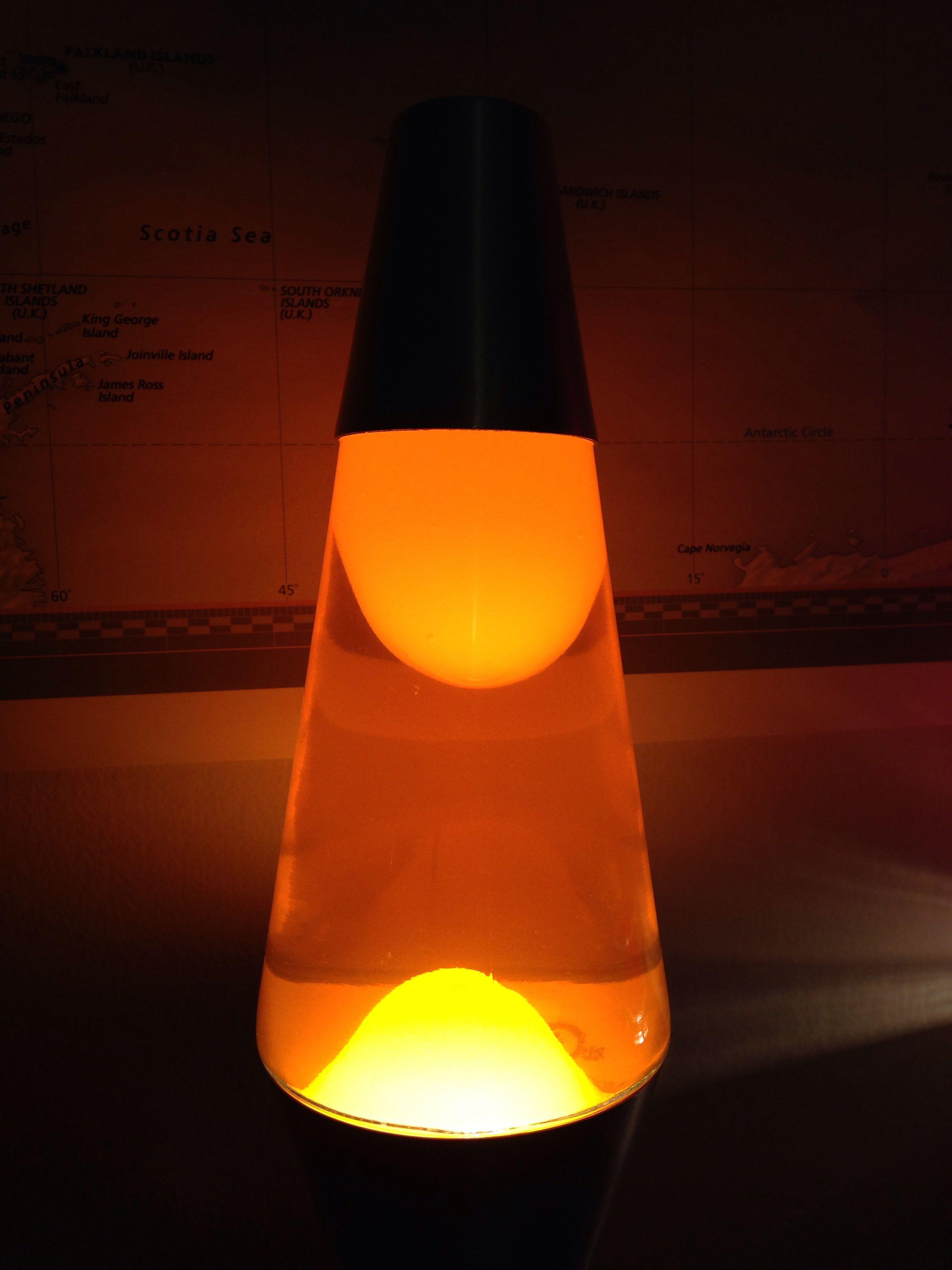Eleven Inch Lava Lamp With Orange Liquid And White Wax