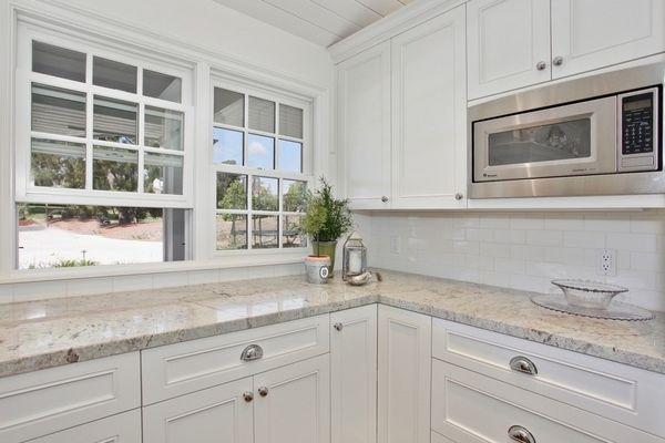 White Cabinets White Subway Tile Backsplash Bianco Romano Granite Countertop Modern Kitchen
