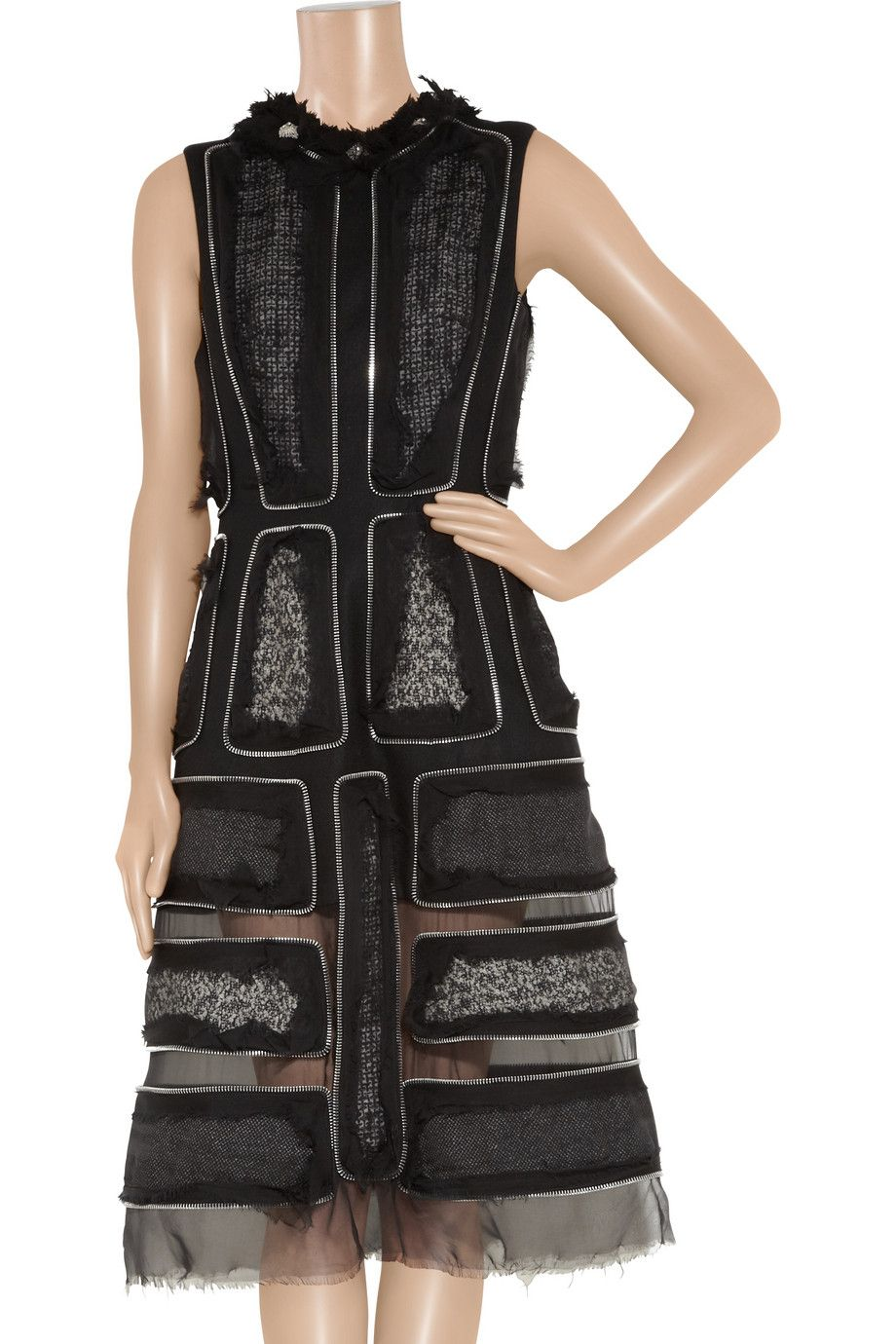 """Alexander McQueen  Zip-trimmed tweed and wool-felt dress  Was $8,795 Now $4,397.50 50% OFF        Editor's notes        Details      Size & fit    """"I was thinking about an ice queen,"""" said designer Sarah Burton of her muse for fall's dramatic Alexander McQueen collection. Tweed, wool-felt and silk-chiffon are combined with breathtaking workmanship to create this exquisite dress. Frayed edges give a raw finish - complement the effect with a dramatic belt and heels."""