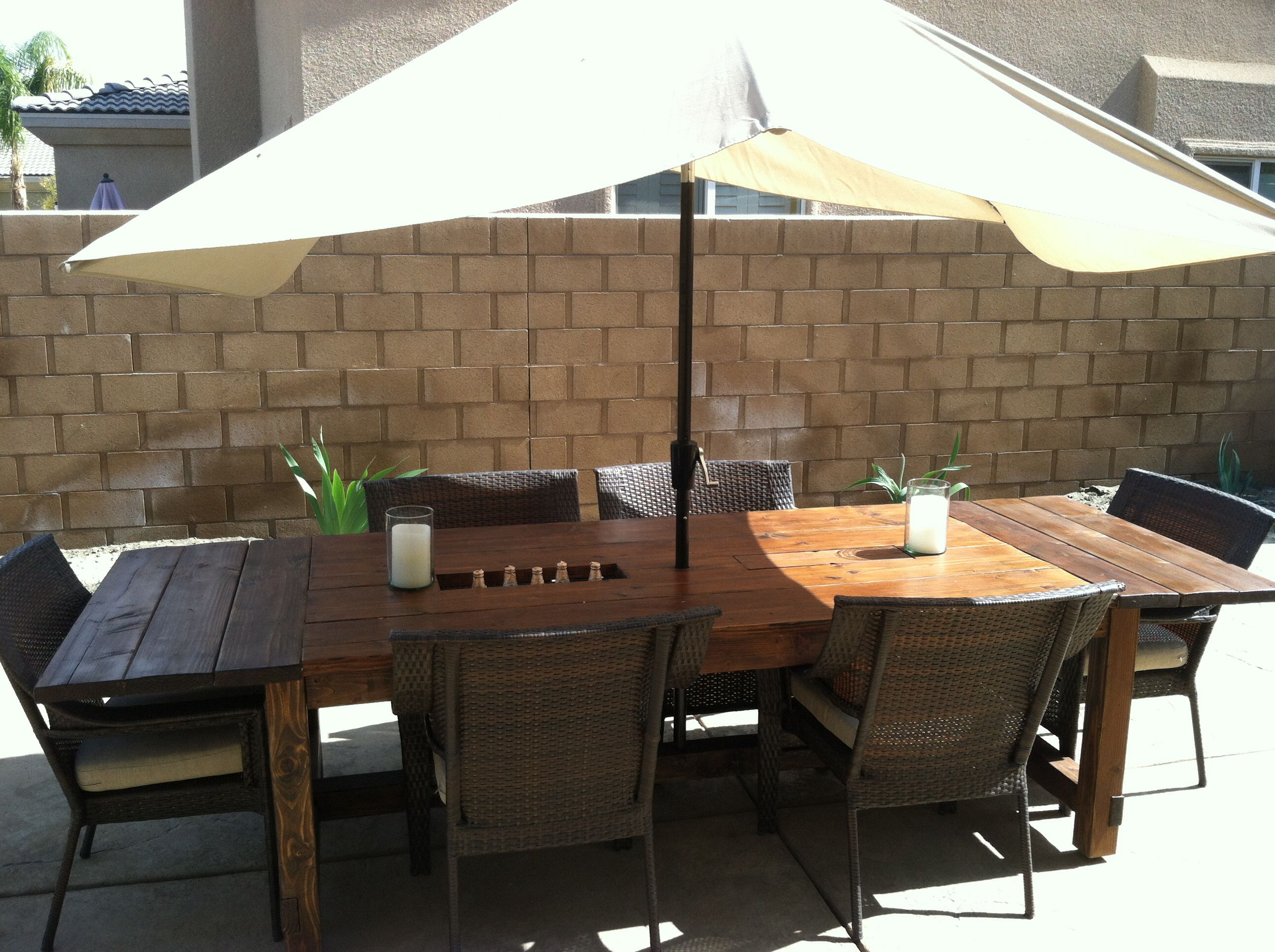 DYI farmhouse table with built in coolers and umbrella stand on