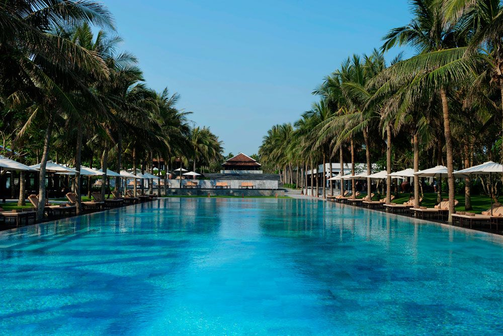 Guests At The Ultra Chic Beachfront Nam Hai Resort In Vietnam Can Luxuriate Poolside Their Villas