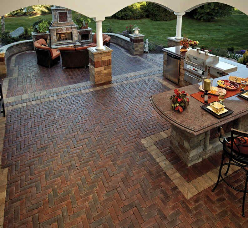 Patio Of A Outdoor Kitchen With Unilock's Copthorne Brick