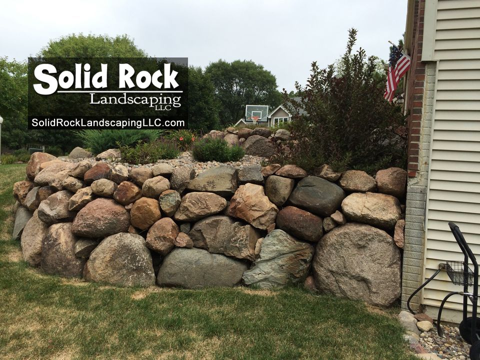 Pin By Solid Rock Landscaping Llc On Retaining Walls Landscaping With Rocks Timber Walls Retaining Wall