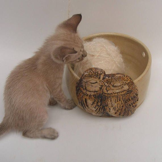 This yarn bowl comes with a gift of ring holder, near the wings of the owls there are two slots to tie a ribbon for a ring of course it can also be used for other things you choose(-: I made the kissing owls relief from porcelain + clay of the bowl, It gives more depth after glazing(-:
