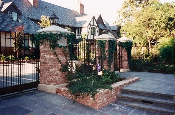 Britishstoneworks built these brick piers with Santa Barbara sandstone bases and caps graced this Brentwood, CA property with Bluestone paving