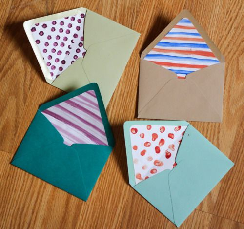 Line your envelopes with hand painted paper. Lots of great ideas here at this URL
