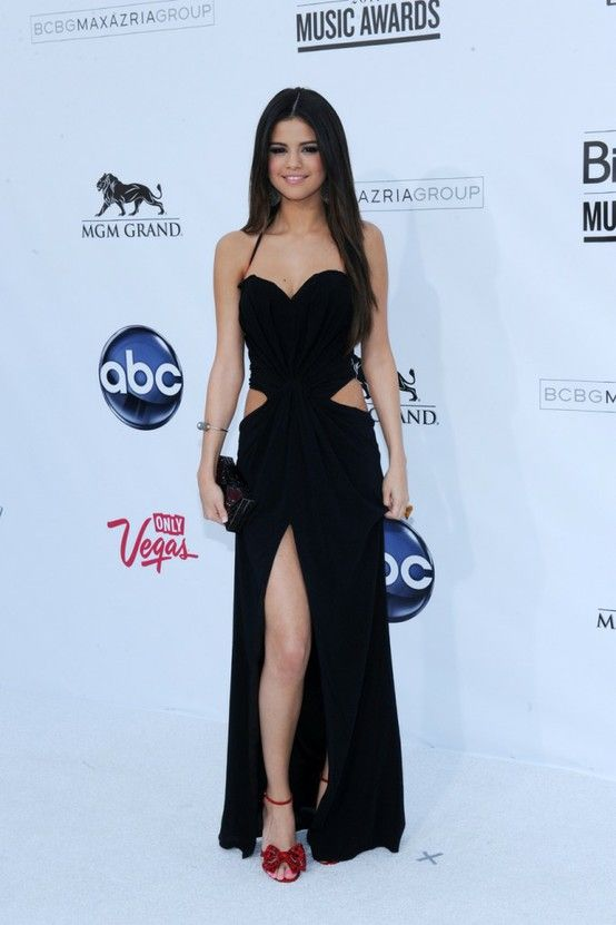 Fashion icon: Selena Gomez. Black gown with cut outs and high slit ...