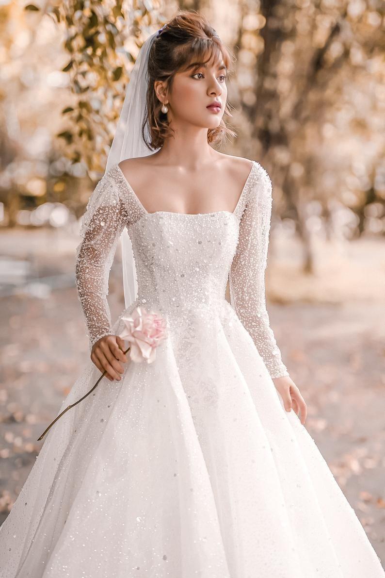 Daria Ballgown Sparkly Wedding Dress Long Sleeve Bridal Gown In 2021 Long Sleeve Bridal Gown Sparkly Wedding Dress Long Wedding Dresses [ 1191 x 794 Pixel ]