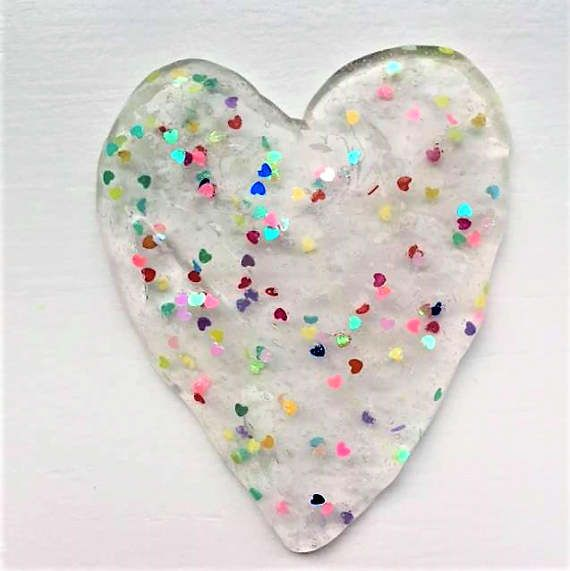 Love Slime- crystal clear slime, with multi-colored hearts (confetti). Perfect gift for someone you love or like. Great for poking and stretching. Discounted shipping for ordering two or more slimes. Keep slime away from carpets, fabric, furniture, young children and pets. Do not eat. Note: Our shop does not accept refunds, cancellations or exchanges. Please contact us directly if there is a problem with your order prior to leaving feedback and we will work with you to make it right. Bb...