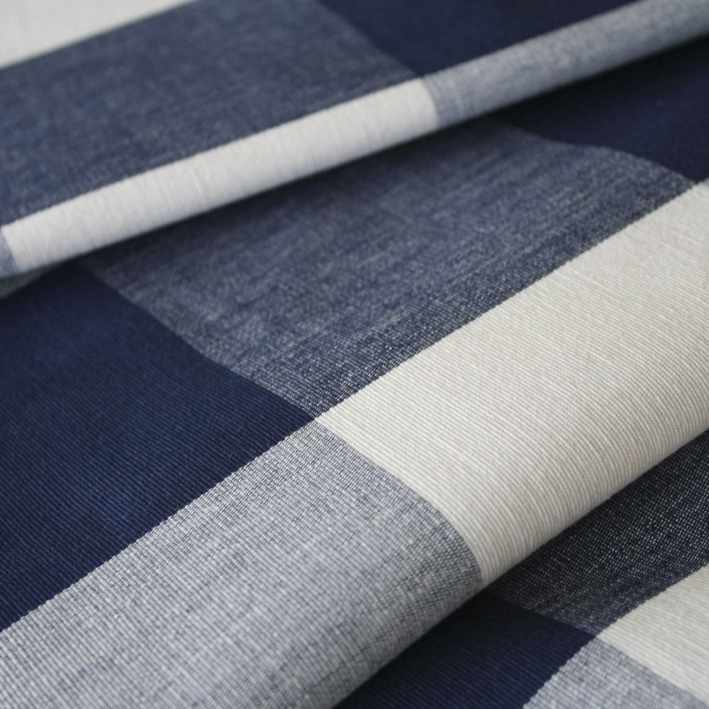 A Classic, Navy Blue Buffalo Check Fabric With A Warm