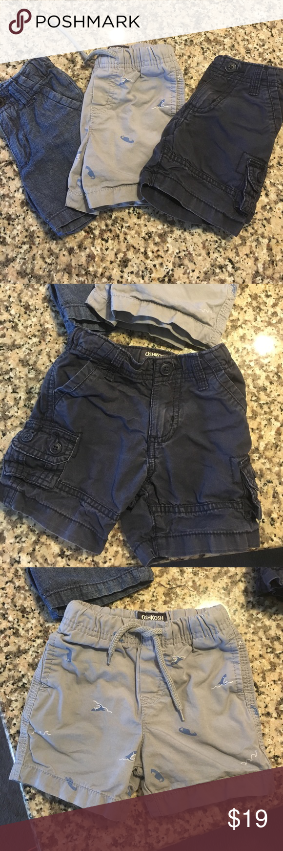 Set of 3 OshKosh boys shorts Perfect for summer! Set of boys shorts. The navy cargos and chambray shorts both have an adjustable waist (inside). The shark pair are elastic w/ a tie front. Osh Kosh Bottoms Shorts