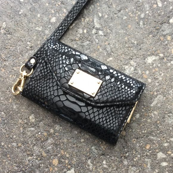 NWOT Michael Kors Snakeskin Card and iPhone Case NWOT Michael Kors Snakeskin Card and iPhone Case - Fits iPhone 4 - 4-3/4 X 3 Michael Kors Bags Clutches & Wristlets