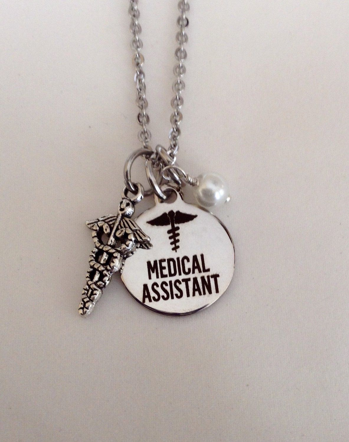 A personal favorite from my Etsy shop https://www.etsy.com/listing/255229080/medical-assistant-necklace-ma-jewelry