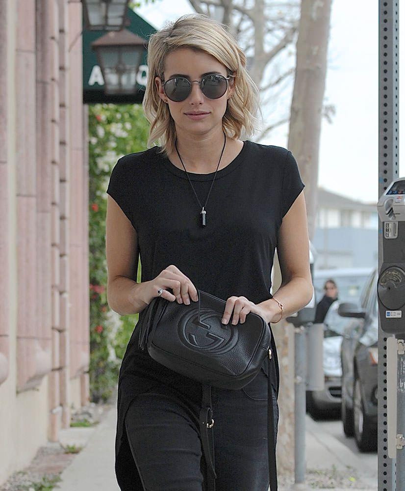 de4ff498bdc Emma Robert carrying a Gucci Soho Disco bag