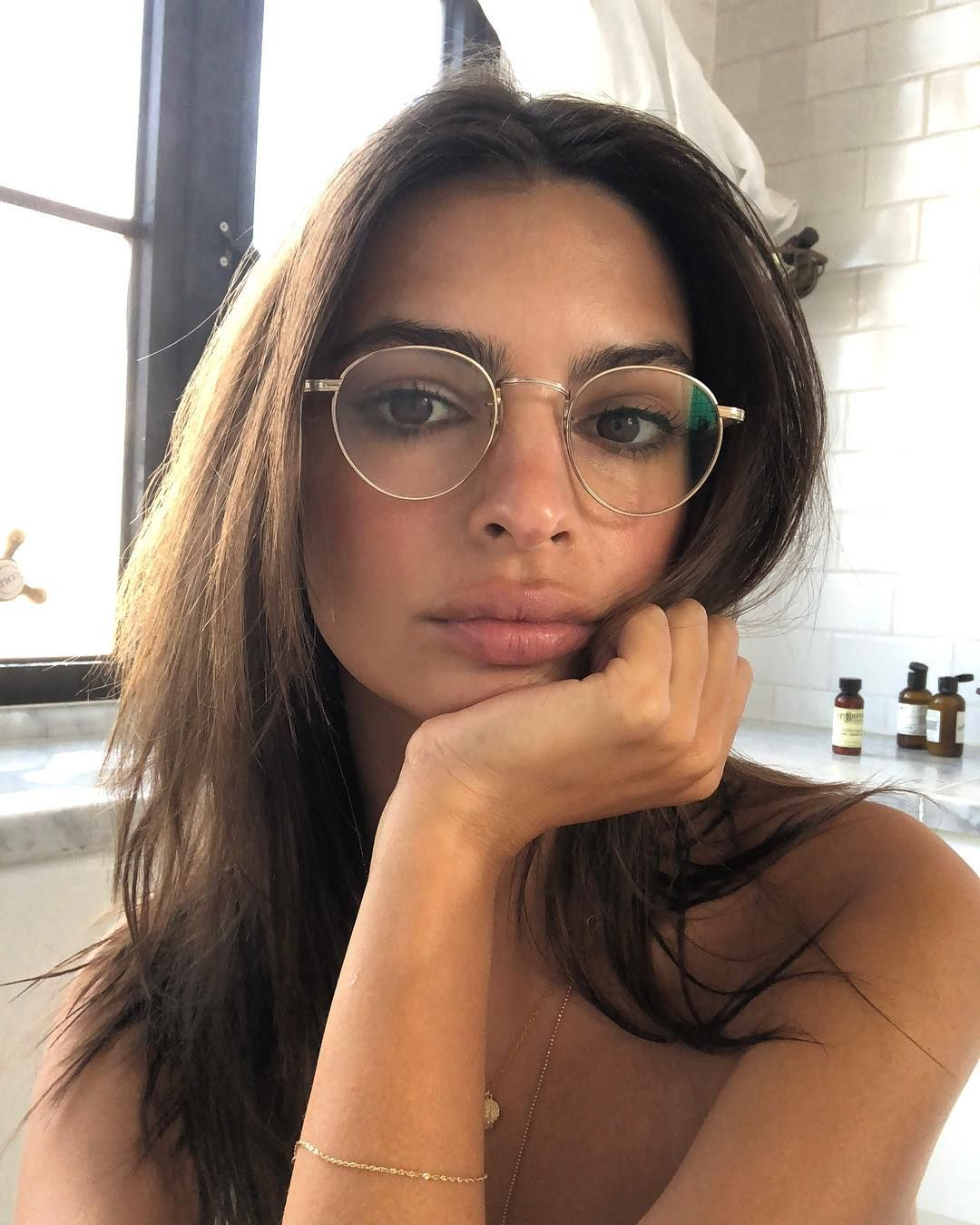 38b1c2820a36 Emily Ratajkowski wearing the GARRETT LEIGHT    WILSON M. Wilson M offers  an iconic round metal shape with filagree detailing and acetate temples.