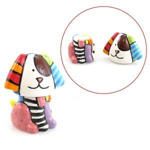Dog Salt & Pepper Shakers Romero Britto by Romero Britto. $31.00. Dog Salt & Pepper Shakers Romero Britto. Stacking Salt and Pepper Shakers: DogThis cleverly shaped Salt and Pepper set looks like an adorable pup when stacked together. Part of Romero Brittos Tableware collection.  A modern day pop culture icon, Romero Britto of Brazil, has manag