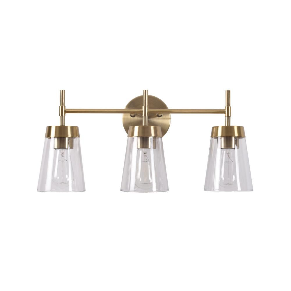 Photo of Manor Brook Bea 3-Light Antique Brass Vanity Light with Clear Glass MB99073 – The Home Depot