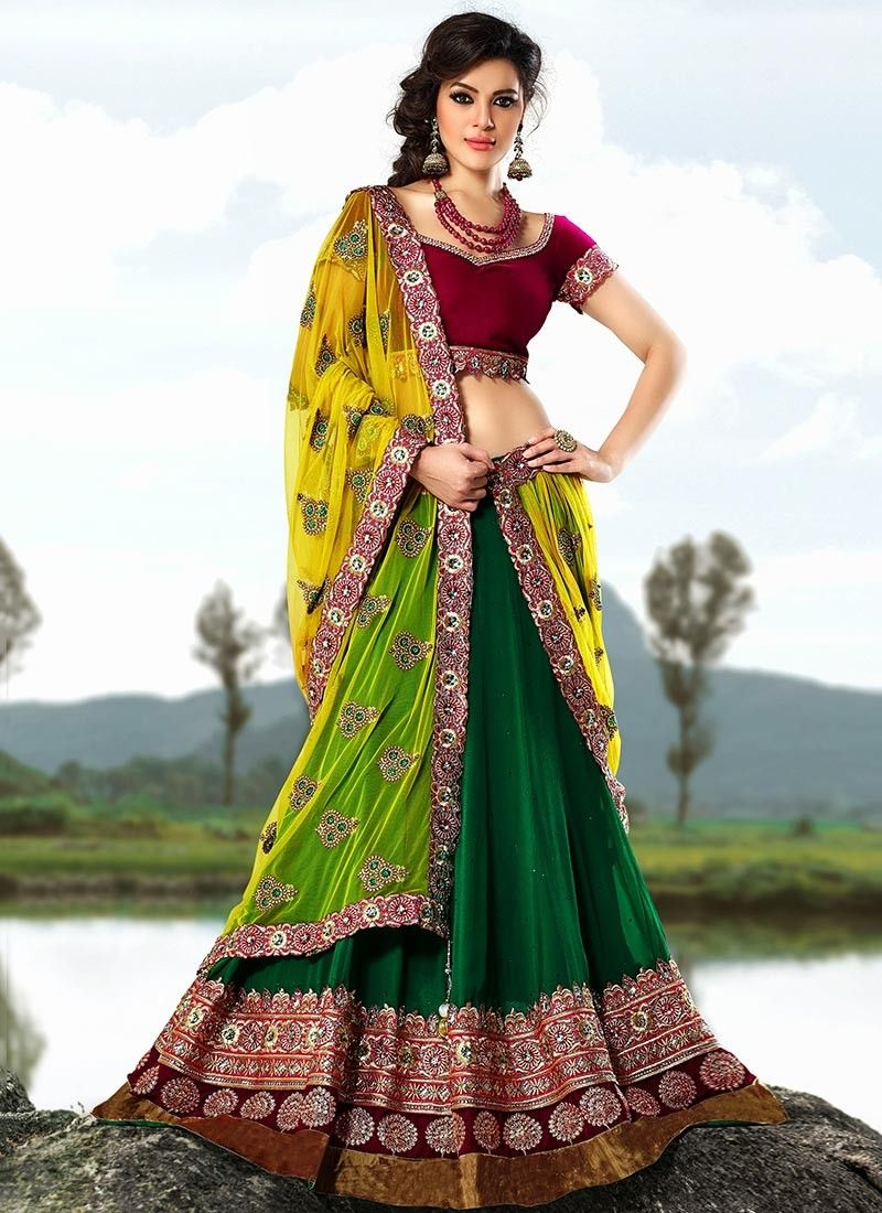 08943c8682 ... green faux georgette and net lehenga choli. Lehenga part featuring  stick on crystals all over with embroidered decorative patterned lower  patch wherei.