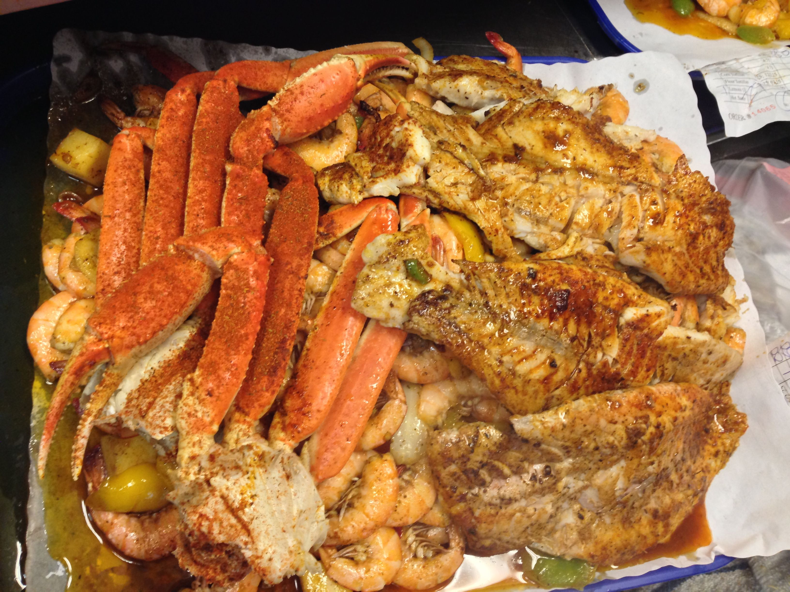 Snow crab and red snapper fillet over shrimp and veggies for San pedro fish market super tray