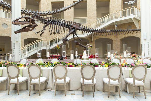 Dinosaur Inspired Wedding At Fernbank Museum 68 Ruffled Dinosaur Wedding Theme Dinosaur Wedding Round Wedding Tables