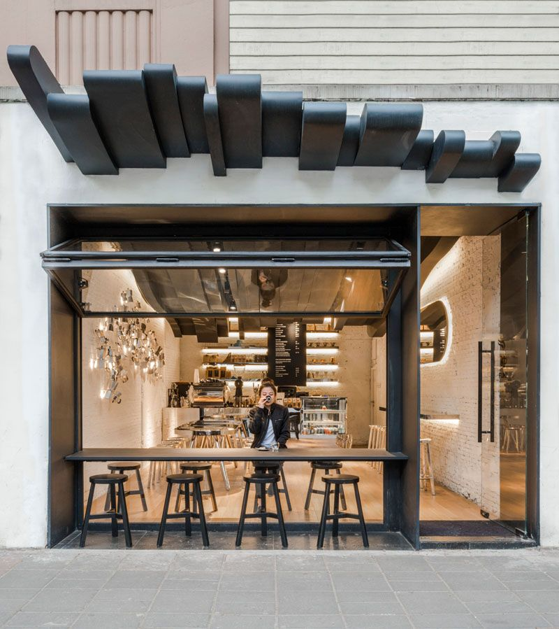 The Sculptural Ceiling In This Cafe Continues From The Inside To The Outside Coffee Shop Interior Design Coffee Shops Interior Cafe Design