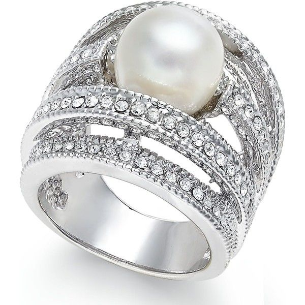 Steal the spotlight. This stunning ring, crafted in sterling silver, features a cultured freshwater pearl (10mm) centerpiece lavished by rows of glittering cub…