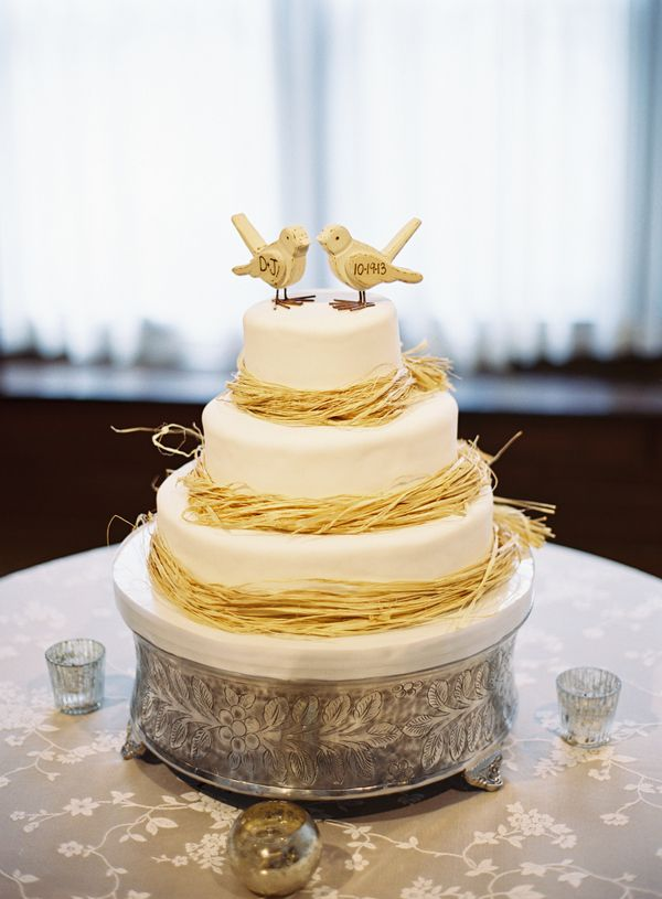 Simple but elegant wedding cake with raffia wrapped around the base ...