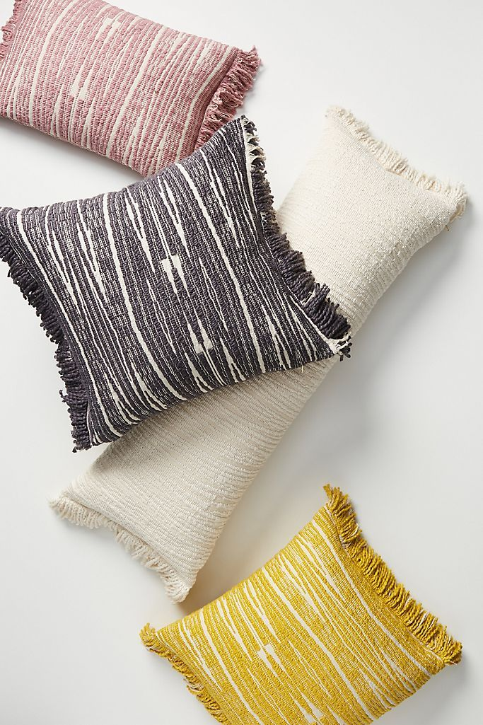 Photo of Throw Pillows in Unique Shapes and Textures
