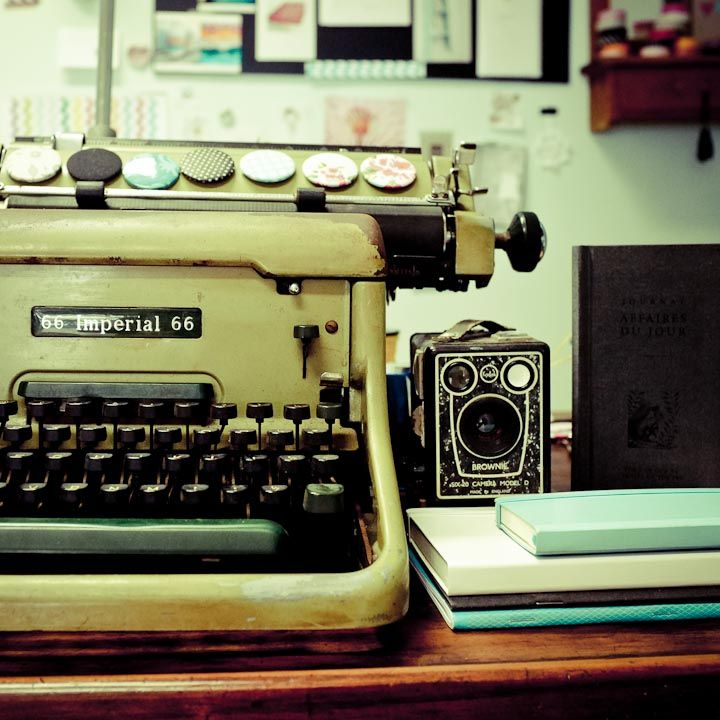 Vintage typewriter and camera