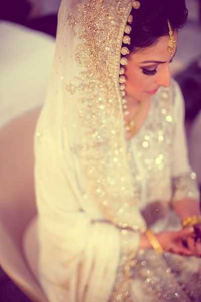 stunning white and gold bridal outfit with gold crystal baubles attached to the dupatta (veil or chunni)