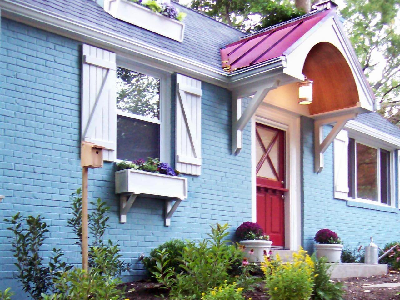 A bright blue paint job makes this cottage home stand out while a a bright blue paint job makes this cottage home stand out while a red front rubansaba