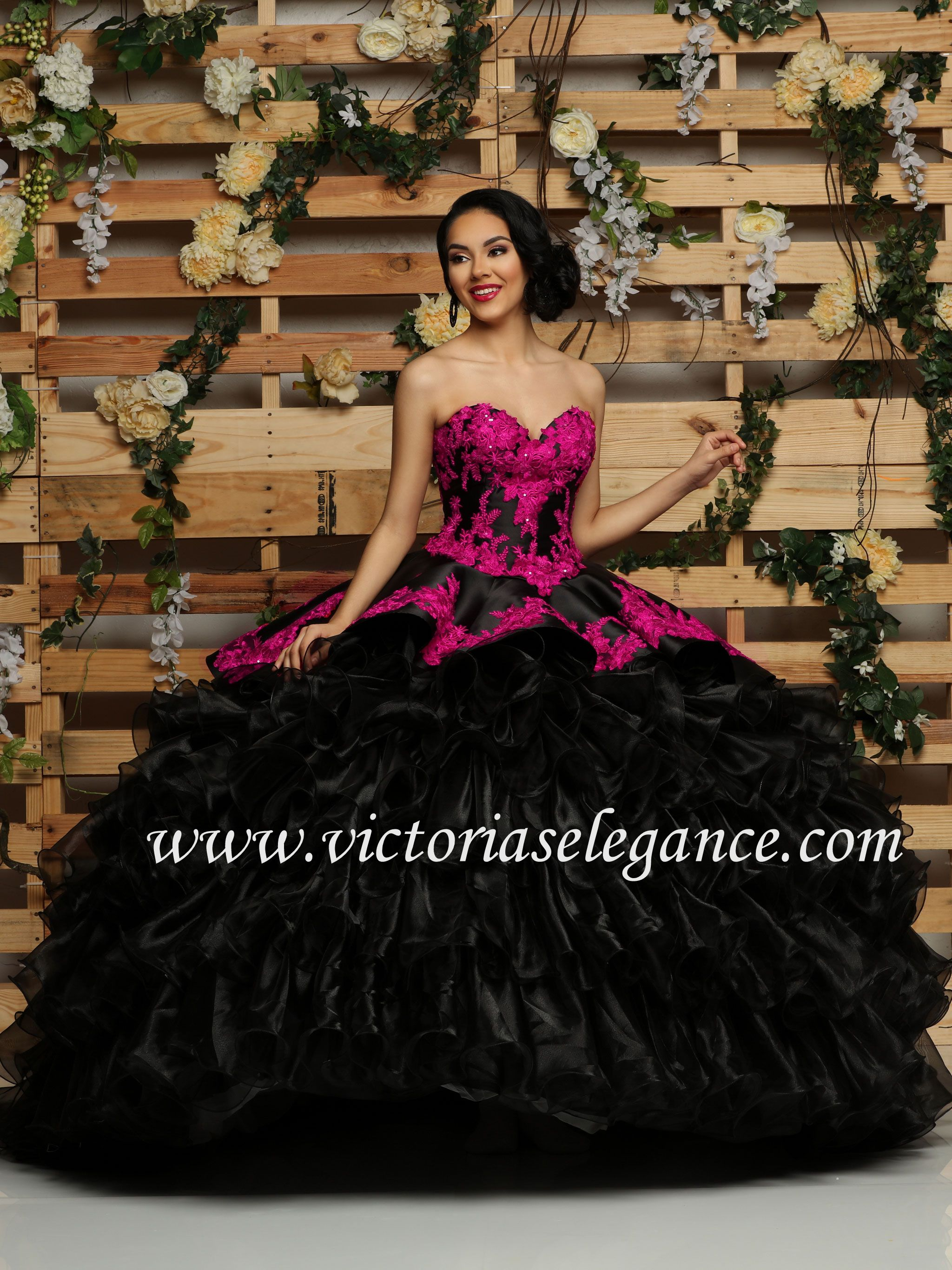 91e3348fc19 This Q by DaVinci satin ball gown features a corset back
