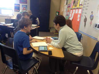 Students collaborate in teams to decide if vocabulary words would be dividing words or multiplication words.