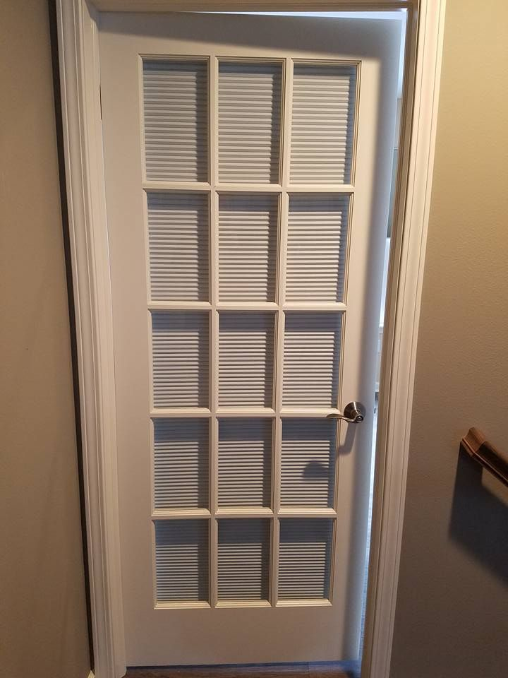 Cellular (honeycomb) shade on a door. Great for insulation, privacy and maintaining decor in all rooms.