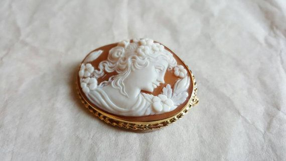 Gold cameo brooch that represents Flora, the goddess of spring and flowers.  #donadiojewelry #cameojewelry #brooch #pendant #gold
